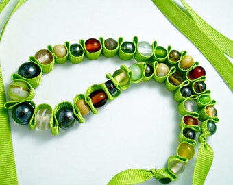 Lime green ribbon, neutral colored glass beads adjustable beaded ribbon necklace. Beaded jewelry. Green necklace.