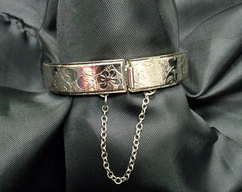 Silver Tone Hinged Cuff Bracelet with Safety Chain