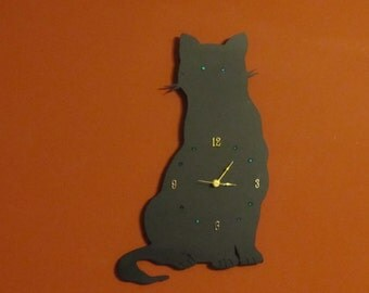 This cat clock with emerald green accented eyes