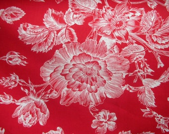 A standout toile with dark cherry red background with white flowers.