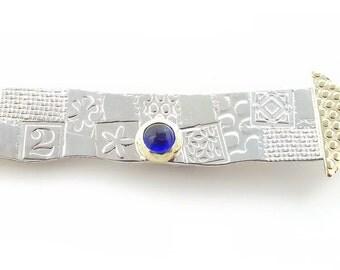 Embossed, patterned Silver & Blue Spinel Brooch