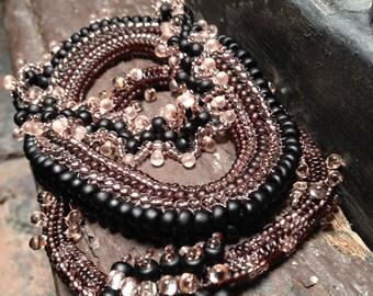 Bracelet set: matte black and shiny pink beaded