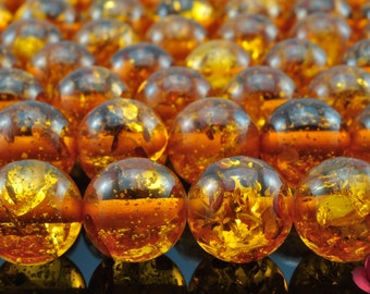 28 pcs of synthetic Amber smooth round beads in 14mm