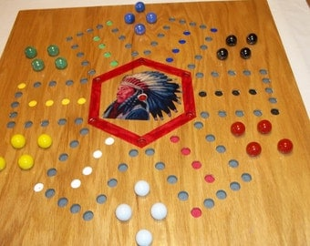 Pegs and Jokers and Marbles 4 & 6 Player Board with Aggravation 6 player on The Back of the Board