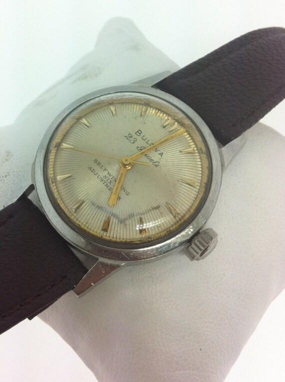 1959 Vintage Bulova Self Winding six Adjustments wrist watch 23 Jewels sun burst dial.