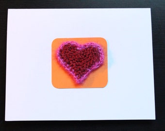 Red knitted heart card