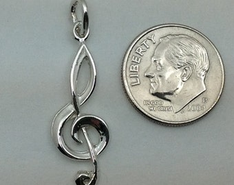Sterling Silver Treble Clef Pendant.