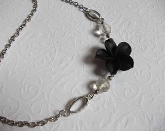 Asymetric black flower necklace