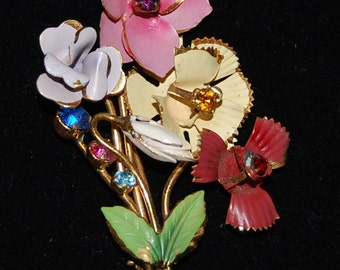 signed austria flower and rindstone brooch