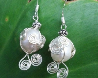 spiraling wire wrapped pearl earrings