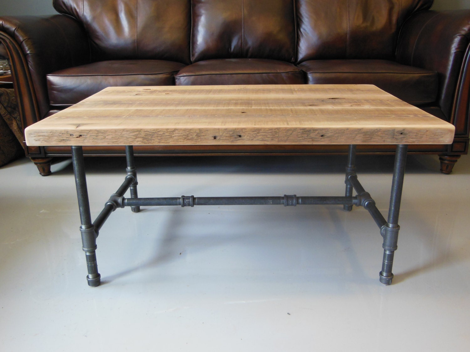 Reclaimed wood coffee table with industrial pipe legs by dendroco Recycled wood coffee table