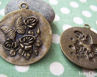 6 pcs of Antique Bronze Butterfly On Flower Round Pendant Charms 43mm A1600