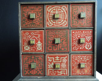 Buddhist amulet box with 9 drawels.