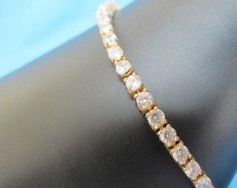 Vintage Clear Rhinestone Tennis Bracelet Gold Tone Estate Jewelry