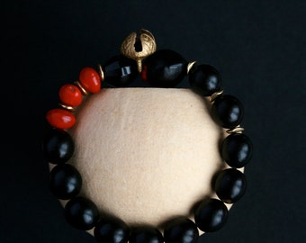 beaded bracelet with natural seeds, nuts and brass bell - ethnic jewelry - tribal bracelet