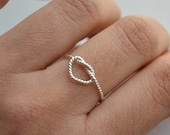 Don't promise me anything .Infinity heart . twisted silver ring