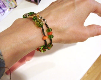 August Peridot Green and Orange Glass Beaded  - Thread Crochet -Sparkly Faceted Glass Bead Bracelet