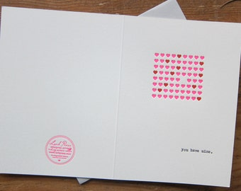 hearts valentine letterpress greeting card with pink and red hearts in typewriter
