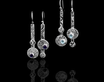 Etched silver earrings with asymmetrical circles and a 5mm amethyst or blue topaz stone. Length is 2 inches.