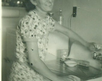 Woman Doing Dishes Standing At Kitchen Sink Clean Up After Dinner  Vintage Photo Black and White Photograph