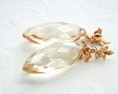 Golden Beige Crystal Earrings with gold-filled studs and gold tone delicate leaves