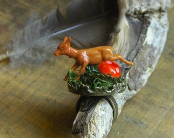 FROLICKING. Whimsical diorama type statement ring with  running deer, mushroom and genuine moss.