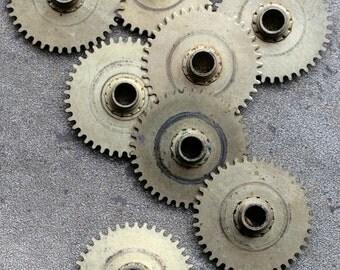 Vintage clock brass gears -- set of 8 -- D12