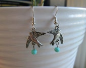 Hypoallergenic silver tone bird earrings with aqua blue rondelle beads