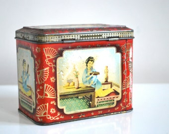 Vintage red tin tea caddy in red and gold, decorative tin box, Christmas decor.
