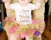 I'm the pink in my daddy's world of camo bodysuit, brown and pink tutu, and matching hair bow with pink, brown, and camouflage