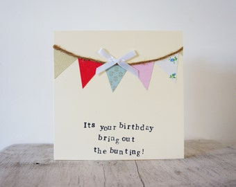 Handmade bunting birthday card, with colourful bunting and white bow.