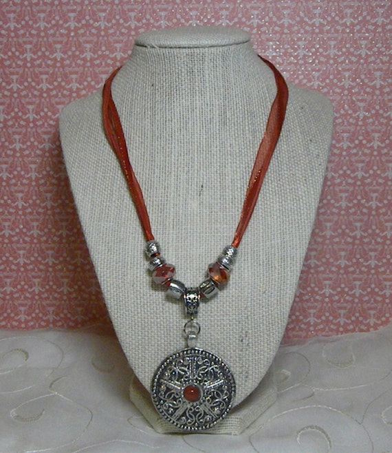 Red and Silver Metal Pendant on a Red Ribbon and Cord Necklace