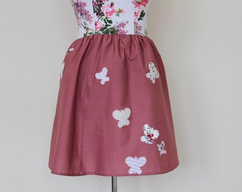 "CLEAR OUT !!! Dusty pink skirt with applique butterflies and elastic waist. Size UK 10 28"" waist"