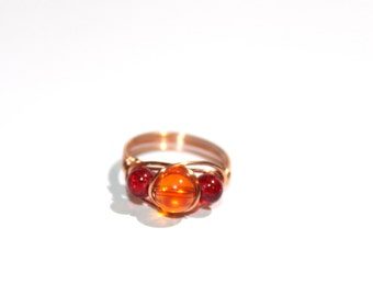 Wire beaded ring in orange and red, copper wire wrapped, any size, beaded jewelry