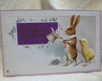 Fantasy rabbit in Top Hat with adoring chick.  A joyful Easter vintage postcard.