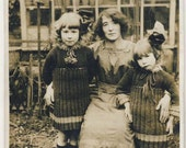 Antique real photograph postcard of mother & her daughters