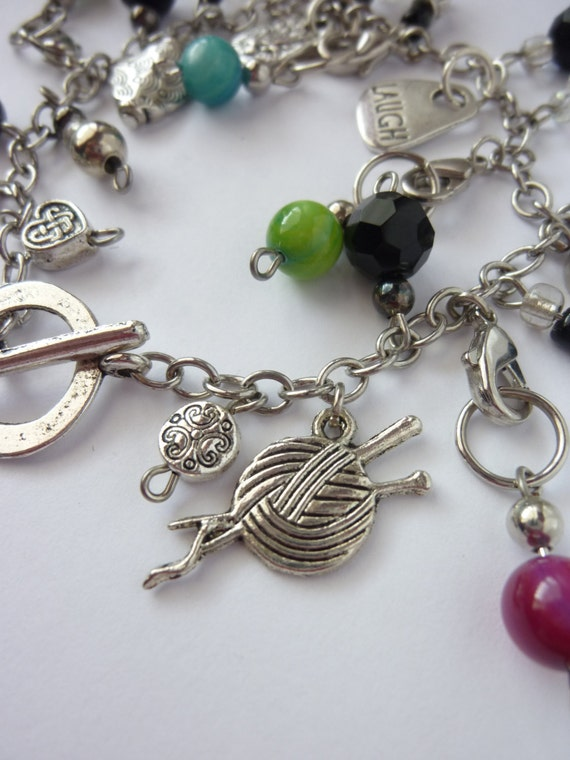 """Silver knitting charm bracelet with 6 removable green/pink/blue knitting stitch markers & """"Laugh"""" charm"""