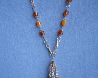 Fun and Swingy Vintage Amber and Brown Lucite Beaded Chandelier Tassel Necklace, Circa 1960s, 1970s
