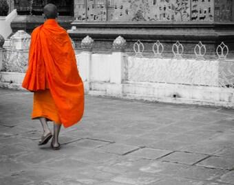 Orange-Clad Monk in Luang Prabang. Laos. Travel Photography. Print by OneFrameStories.