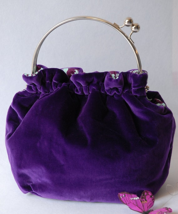 Purple velvet handmade handbag with metal frame