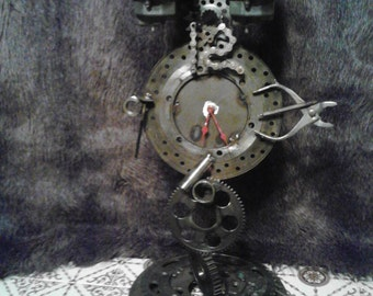 Steampunk - metal clock  made from motorcycle parts welded together- steampunk, auto parts,repurposed,  found items