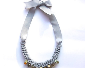 Necklace made of  'Gold' hex nuts box-weaved with grey ribbon