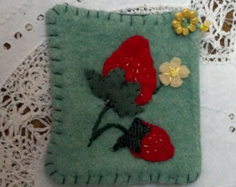 Wool clutch with embelishments