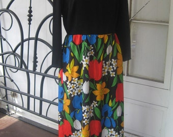1960s Vintage Groovy Maxi Dress, Black with Bright and bold Floral Print Skirt Size Medium / Large