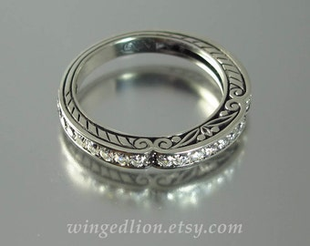CARYATID wedding band in 14k gold with white sapphires