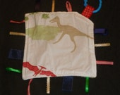 Pottery Barn Kids Dinosaurs supersaurus tan red ptaradactyl On-the-go boy Ribbon Lovey Taggie Blanket made with Pottery Barn Kids