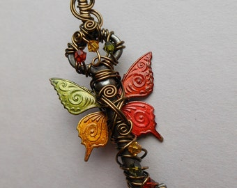 Butterfly Winged Key Pendant -- Autumn Red, Orange, Yellow, Green Patterned Butterfly Winged Wire Wrapped Antique Key with Swarovski Crystal