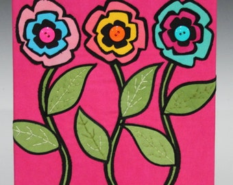 Three flowers on a pink background fiber art