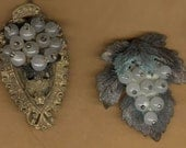 vintage dress clips, two old dress clips what are they now  brass verdigris oldness