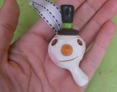 Christmas Snowman Folk Art Ornament in white green and blue top hat